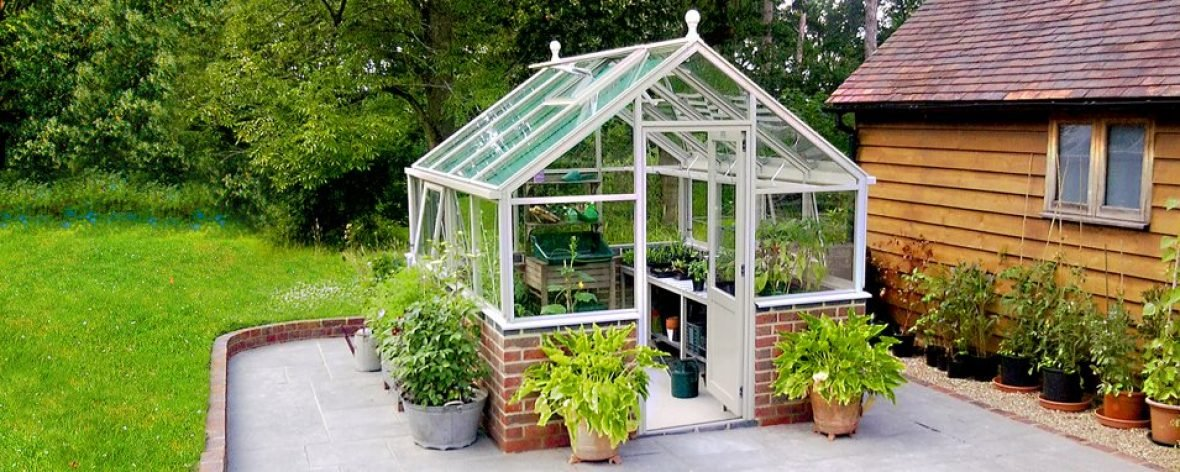 Front Entrance of a White Hartley Botanic 8x8 Tradition 8 Greenhouse.