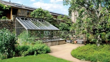 Bespoke Hartley Botanic lean-to greenhouse in a garden