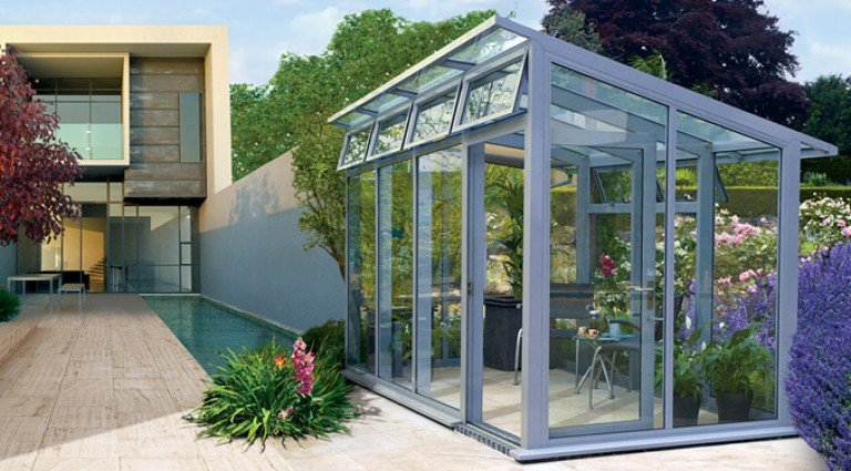 Bespoke contemporary greenhouse by Hartley Botanic in grey