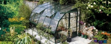 The Hartley Botanic Lean-to lass to ground greenhouse with sliding doors