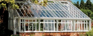 A White Hartley Botanic Lean-To Greenhouse