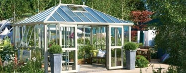Front Left View of a White Hartley Botanic Westminster Greenhouse