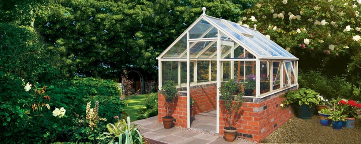 Close Up of a White Hartley Botanic 8x8 Tradition 8 Greenhouse With Brick Base.
