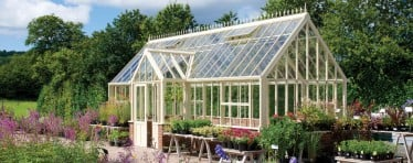 A white Hartley Botanic Victorian glasshouse