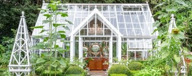 White Hartley Botanic Glasshouse in a Garden