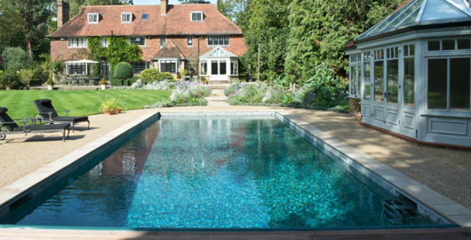Outdoor pools in the uk fancy or folly by thomas jones for Small garden swimming pools uk
