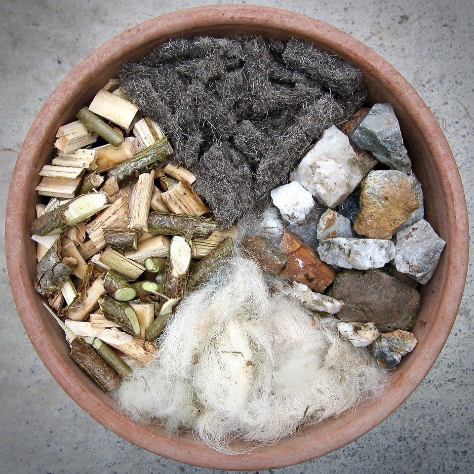Using stones, shredded prunings and sheep's wool for gardening.